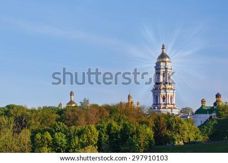 Orthodox Christian monastery - Kiev Pechersk Lavra in Kiev on green hills of Pechersk - stock photo