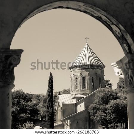 Orthodox Church and Nunnery of St. Nino in Mtskheta. Religion landmark of ancient Georgia. Vintage photo travel in retro style. - stock photo