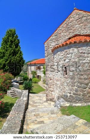 Orthodox church building in sunny Mediterranean area, Montenegro - stock photo