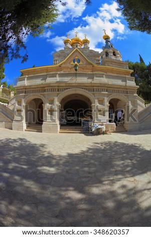 Orthodox Church of Mary Magdalene in Jerusalem. Above the triangular portico golden domes topped with golden crosses - stock photo