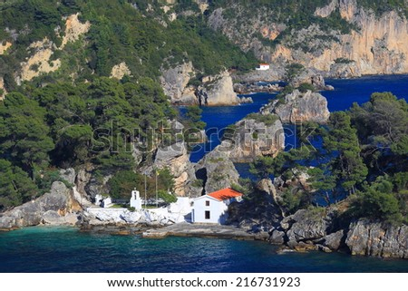 Orthodox church surrounded by sea on a Greek island, Parga, Greece - stock photo