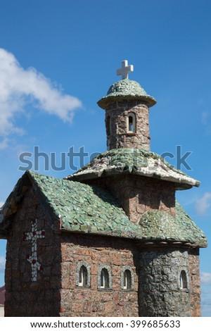 Orthodox stone church against the sky. Miniature - stock photo