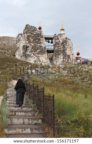 Orthodox temple carved out of natural rock, Russia, Voronezh region, village Kostomarovo, Spassky cave temple, 2013 - stock photo
