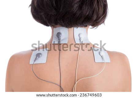 Orthopaedic treatment electrostimulator. Electrodes of the girl in neck. - stock photo