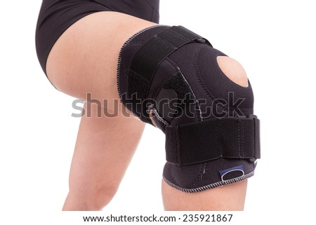 Orthopedic bandage on his knee. Sprain the leg muscles. - stock photo