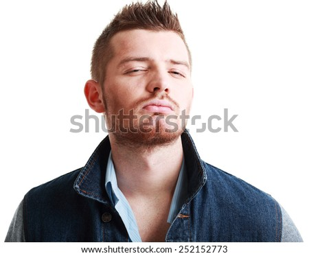 ortrait of a handsome young man, over white background - stock photo