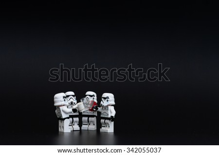 Orvieto, Italy - November 15th 2015: Group of Star Wars Lego Stormtroopers mini figures drunk a beer. Lego is a popular line of construction toys manufactured by the Lego Group - stock photo