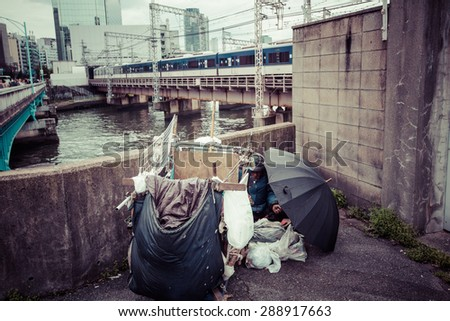 OSAKA, JAPAN - APRIL 12: Homeless in Tokyo, Japan on April 12, 2015. Grown noticeably in Japanese society since the collapse of asset price bubble across the 1990s - stock photo