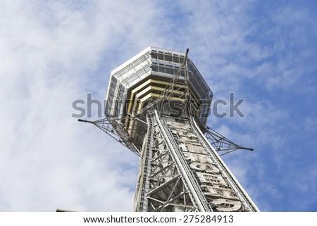 OSAKA ,JAPAN-APRIL 22 : Tsutenkaku Tower on April 22,2015 in Osaka. It is a tower and well-known landmark of Osaka, Japan and advertises Hitachi, located in the Shinsekai district of Naniwa-ku, Osaka. - stock photo