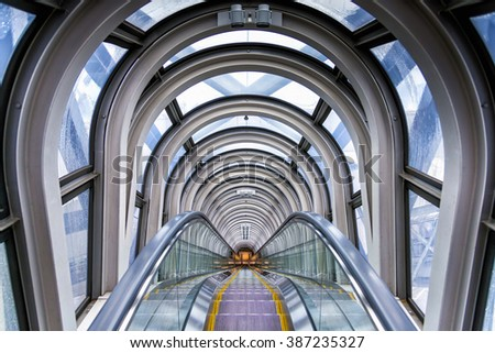 Osaka, Japan - April 29, 2014: View of the spectacular escalator in Umeda Sky Building, a modern high rise skyscraper in the Kita district of Osaka, near Umeda Stations. - stock photo