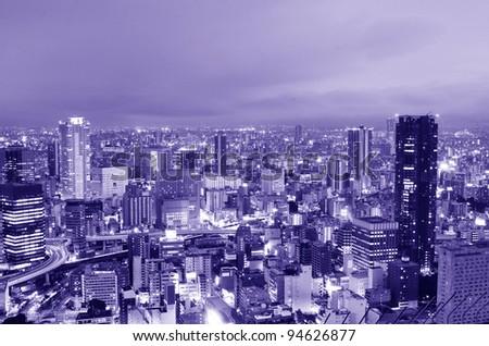 Osaka, Japan at night in blue - stock photo