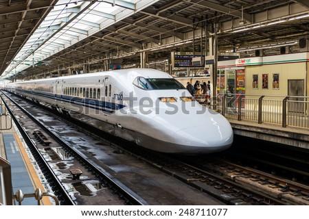 OSAKA, JAPAN - DECEMBER 29: A Shinkansen train pulls into Shin Osaka Station on December 29, 2014 in Osaka, Japan. - stock photo