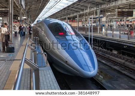 "OSAKA, JAPAN - DECEMBER 4: the 500 Series bullet train at Shin Osaka station on December 4,2012 in Osaka, Japan. 500 Series service as ""Kodama(Echo)"" for Sanyo  Shinkansen line (Osaka - Hakata route). - stock photo"