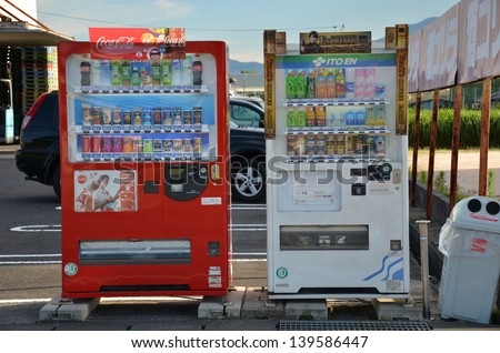 OSAKA, JAPAN - JULY 12: Vending machine in Osaka, Japan on July 12, 2011. Japan has the highest number of vending machines per capita, with about one machine for every twenty-three people.[ - stock photo
