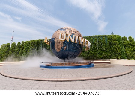 "OSAKA, JAPAN - JUN 3, 2015 : Photo of famous globe with the sign of ""UNIVERSAL"" at Universal Studio, Osaka, Japan. Selective Focus, Blur Background. Toned Photo, Vivid Filter - stock photo"