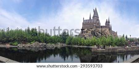 OSAKA, JAPAN - JUN 2, 2015 : Photo of Hogwarts School of Witchcraft and Wizardry replica at The Wizarding World of Harry Potter Attraction, Universal Studio, Osaka, Japan. Panorama view, Toned Photo. - stock photo