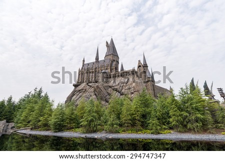 Osaka, Japan - Jun 3, 2015 : Visitors enjoying the Harry Potter themed attractions and shops at the Hogsmeade Village inside Universal Studios of Adventure theme park - stock photo