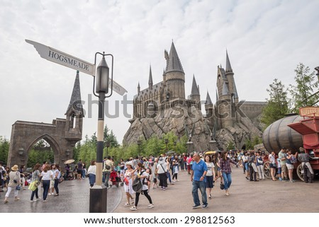 Osaka, Japan - Jun 9, 2015 : Visitors enjoying the Harry Potter themed attractions and shops at the Hogsmeade Village inside Universal Studios of Adventure theme park - stock photo
