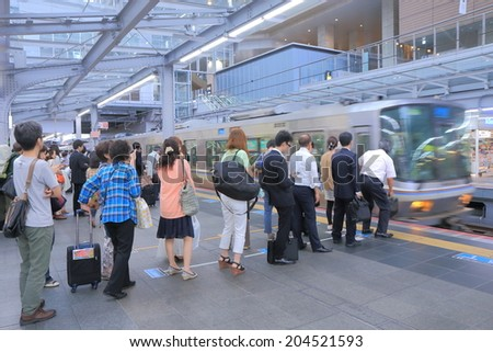 OSAKA JAPAN - 3 JUNE, 2014: Unidentified people commute at JR Osaka Train station. Osaka station is the major railway station in the Umeda district.  - stock photo