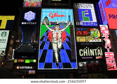 Osaka, Japan - May 26, 2013: Glico billboard displaying the image of a runner crossing a finishing line, is an icon of Dotonbori, a famous tourist destination for nightlife and entertainment area. - stock photo