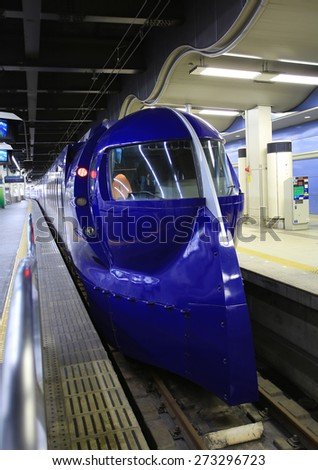 OSAKA,JAPAN, NOV.22: Nankai train depart from  Osaka station on 22 novenmber 2014. Rail transport services are well developed  in Japan and they are provided by more than 100 private companies. - stock photo