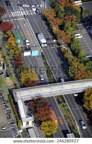 OSAKA, JAPAN-NOVEMBER 11, 2014; Birdview of street in Rinku-Town with cars driving on the left. November 11, 2014,Osaka, Japan - stock photo