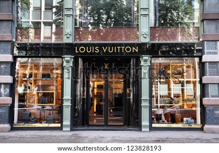 OSLO - AUGUST 21: Louis Vuitton store on August 21, 2010 in Stockholm. Forbes says that Louis Vouitton was the most powerful luxury brand in the world in 2008 with $19.4bn USD value. - stock photo
