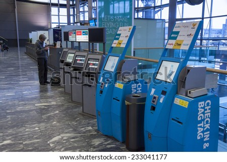 OSLO GARDERMOEN, NORWAY -  NOVEMBER 3: Check in machine at Oslo Gardermoen International Airport on november 3, 2014 in Oslo. The airport has biggest passenger flow in Norway. - stock photo