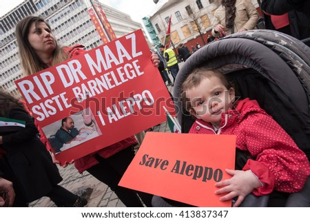 OSLO - MAY 1: Syrian refugees protest violence in Aleppo during the May Day parade in Oslo, Norway, May 1, 2016. - stock photo