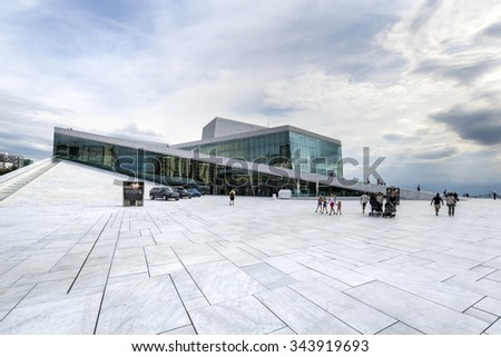 OSLO, NORWAY - AUGUST 24, 2015: The Oslo Opera House in Norway.  The angled exterior surfaces of the building are covered with white granite and make it appear to rise from the water. - stock photo