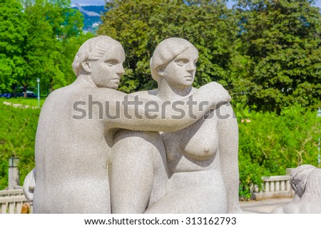OSLO, NORWAY - 8 JULY, 2015: Stone sculpture showing woman and man sitting facing each other as part of the Vigelandsparken sculptures. - stock photo