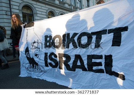 "OSLO - OCTOBER 17: Activists hold a banner reading ""Boycott Israel"" during a protest in solidarity with Palestine near the Israeli embassy in Oslo, Norway, October 17, 2015.  - stock photo"
