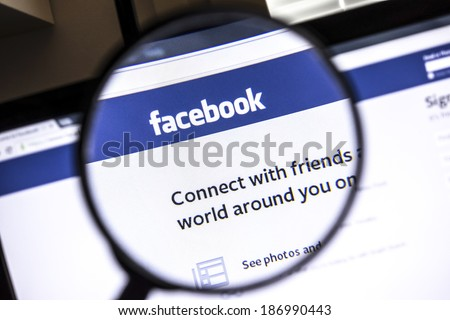Ostersund, Sweden - April 13, 2014: Facebook website under a magnifying glass. Facebook is the largest social media network on the web,  - stock photo