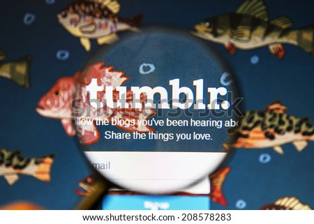 Ostersund, Sweden - August 2, 2014: Close up of tumblr website under a magnifying glass.Tumblr is a microblogging platform and a social networking website  - stock photo