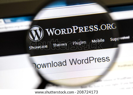 Ostersund, Sweden - August 3, 2014: Close up of Wordpress website under a magnifying glass. WordPress is a free and open source blogging tool. - stock photo