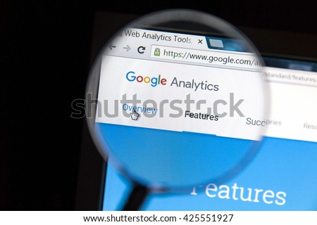 Ostersund, Sweden - May 23, 2016: Google Analytics website under a magnifying glass. Google Analytics is a web analytics service offered by Google. - stock photo