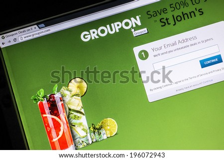 Ostersund, Sweden - May 30, 2014: Groupon website displayed on a computer screen. Groupon is a deal-of-the-day website that features discounted gift certificates usable at local or national companies. - stock photo