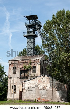 OSTRAVA, CZECH REPUBLIC, JULY 31, 2012 - Old coal mine shaft with a mining tower - stock photo