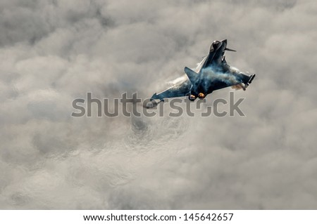 OSTRAVA, CZECH REPUBLIC-SEPTEMBER 23: Italian Eurofighter Typhoon performs during airshow session NATO Days on September 23, 2012 in Ostrava, Czech republic - stock photo