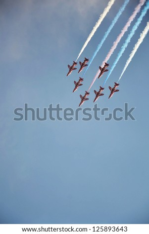 OSTRAVA, CZECH REPUBLIC-SEPTEMBER 22: RAF aerobatic team Red Arrows performs during airshow session NATO Days on September 22, 2012 in Ostrava, Czech republic. 208 000 people visited NATO Days. - stock photo