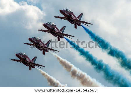OSTRAVA, CZECH REPUBLIC-SEPTEMBER 23: RAF aerobatic team Red Arrows performs during airshow session NATO Days on September 23, 2012 in Ostrava, Czech republic - stock photo