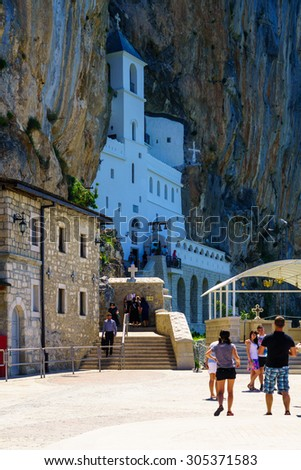 OSTROG, MONTENEGRO - JULY 04, 2015: Pilgrims and other visitors in the Ostrog Monastery, a Serbian Orthodox Monastery in Ostrog, Montenegro - stock photo