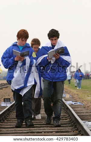 OSWIECIM, POLAND - APRIL 16, 2008: Holocaust Remembrance Day next generation of people from the all the world meets on the March of the Living in German death camp in Auschwitz Birkenau, in Poland - stock photo