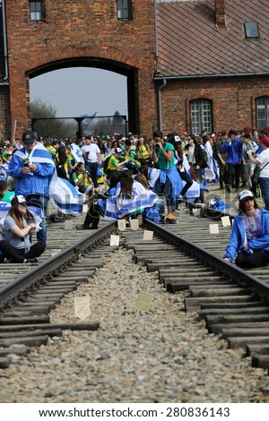 OSWIECIM, POLAND - APRIL 16, 2015: International Holocaust Remembrance Day . Annually people from the all the world meets on the March of the Living in german Concentration Camp in Auschwitz Birkenau. - stock photo