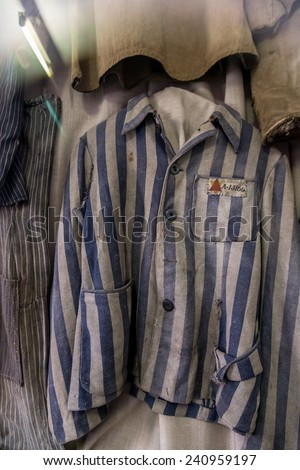 OSWIECIM, POLAND - JULY 22: Exhibition with prisoners' clothes in Auschwitz. It is the biggest nazi concentration camp in Europe on July 22, 2014 in Oswiecim, Poland - stock photo
