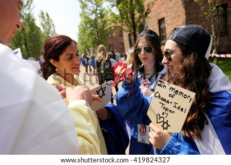 OSWIECIM, POLAND - MAY 5, 2016: International Holocaust Remembrance Day. People from the all the world meets on the March of the Living in german Concentration Camp in Auschwitz Birkenau.Poland  - stock photo