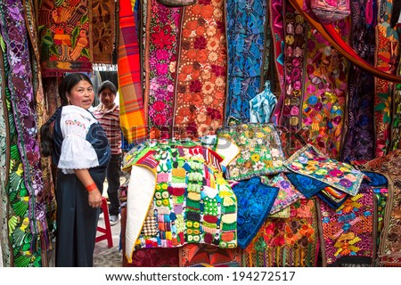 OTAVALO, ECUADOR - AUGUST 4, 2012: Indian women in national clothes sells the products of her weaving, as usual on weekdays on the most famous markets in South America, on August 4, 2012 in Otavalo, Ecuador - stock photo