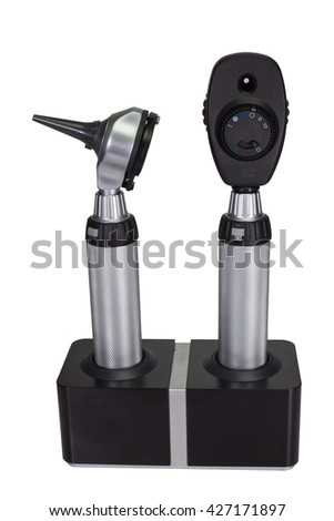 Otoscope and Ophthalmoscope in charger stand on white background. - stock photo