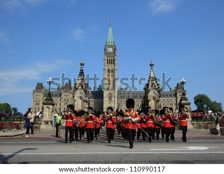 OTTAWA, CANADA - AUGUST 4: Ceremonial Guards leaving Parliament Hill during a Changing of the Guard Ceremony on August 4, 2012 in Ottawa, Ontario. The event occurs each morning during the summer. - stock photo