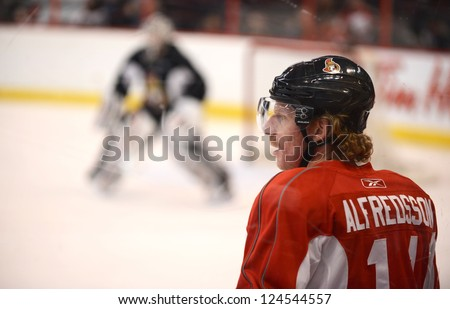 OTTAWA, CANADA - JAN 13:  Captain Daniel Alfredsson of the Ottawa Senators returns to the ice for their first practice of training camp after the NHL lockout was ended.  Jan 13, 2013 Ottawa, Canada. - stock photo
